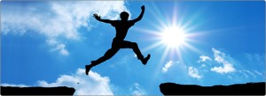 silhouette of person leaping from ledge to ledge to denote success